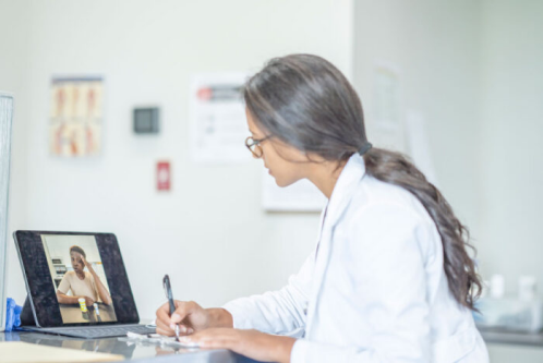 Doctor talking to patient through telehealth