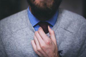 entrepreneur straightening his tie