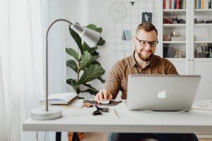 entrepreneur typing on laptop at desk