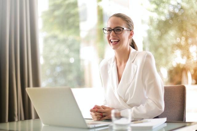 smiling entrepreneur working at laptop