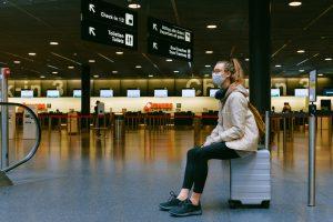 girl wearing mask at airport
